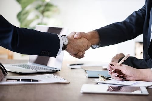 Two professional men making a handshake agreement